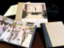 Wedding albums with photographs of bride and groom and wedding party