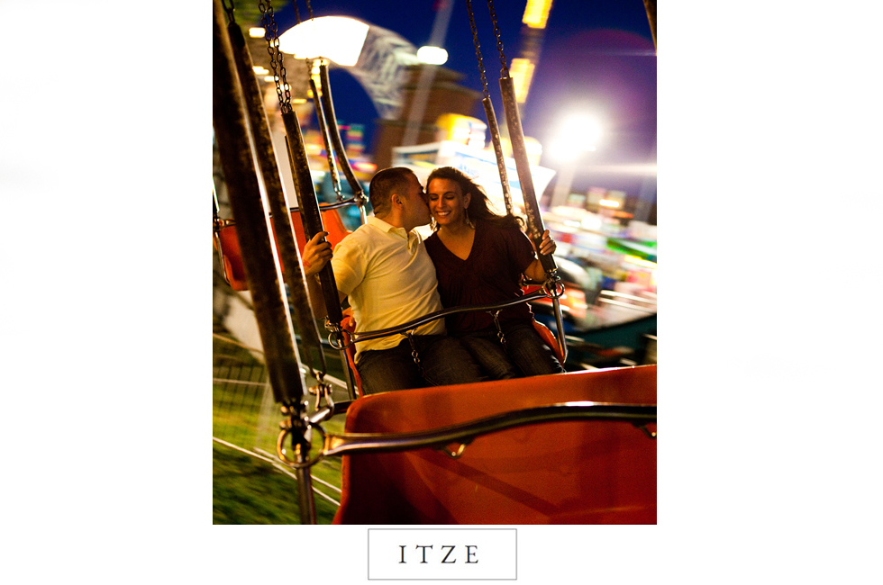 CT engagement photo on swings at Big E fall fair in Massachusetts