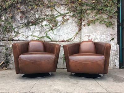 mid century brown leather swivel club chairs