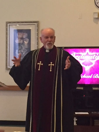 Reverend Pastor Jim Sisk In his robe.JPG