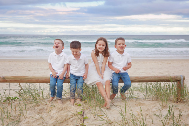 Dr Ces Colagrande - happy kids at beach