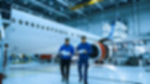 Two aircraft maintenance mechanics have