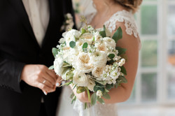 the bride holding wedding bouquet of whi