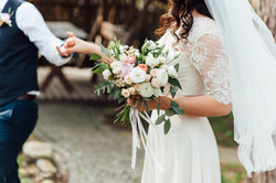 Beautiful wedding bouquet in hands of th