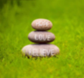Believe, hope and love rock in the grass