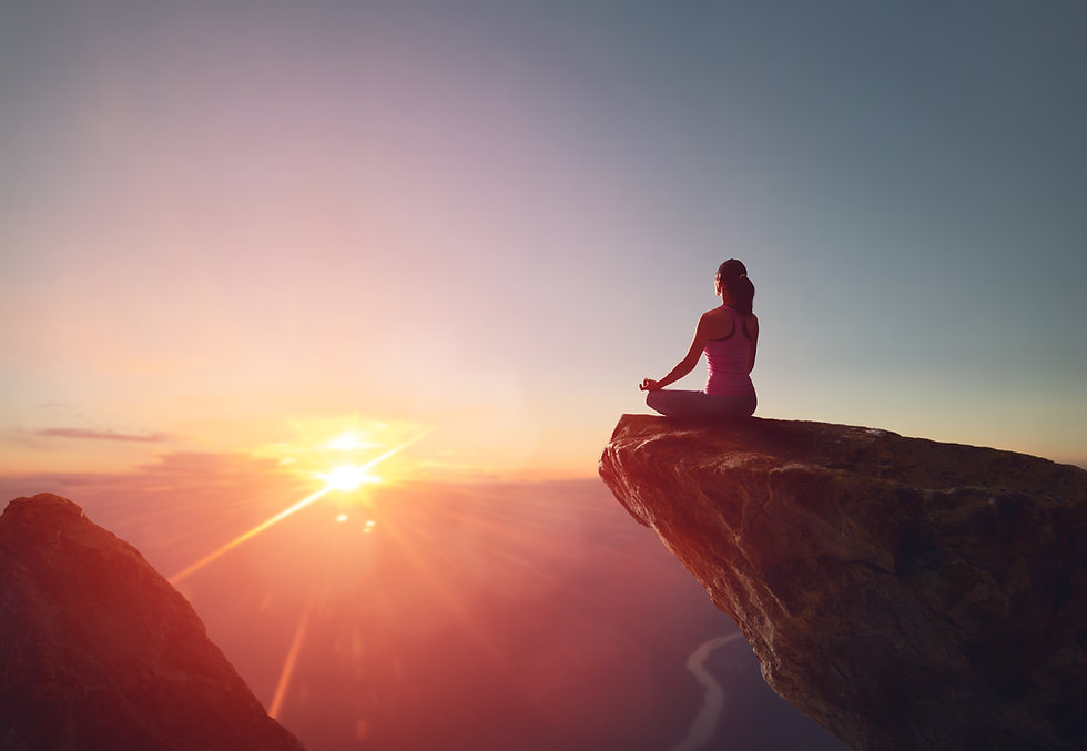 Woman practices yoga and meditates on th