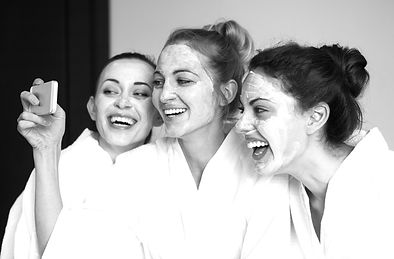 Three young happy women with face masks