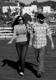YOUNG COUPLE WALKING ON THE PIER
