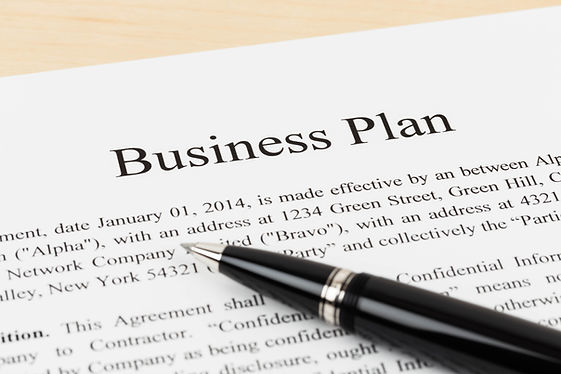 Business plan document with pen.jpg