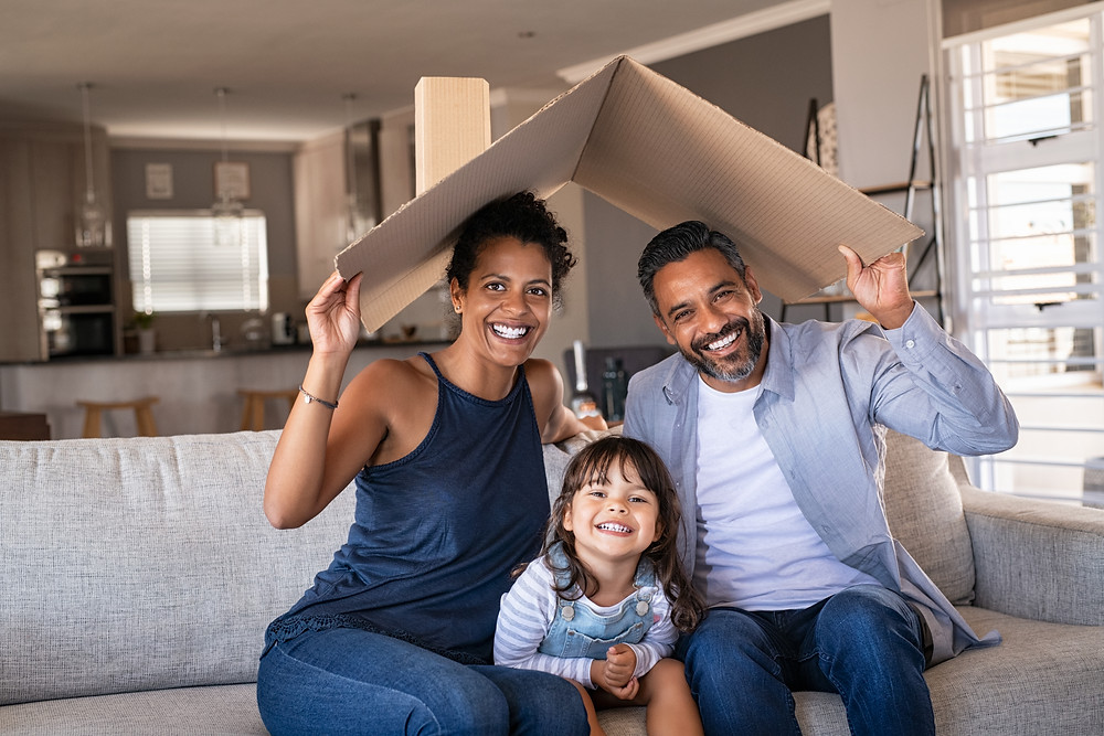 Happy family sitting together with confidence and peace of mind