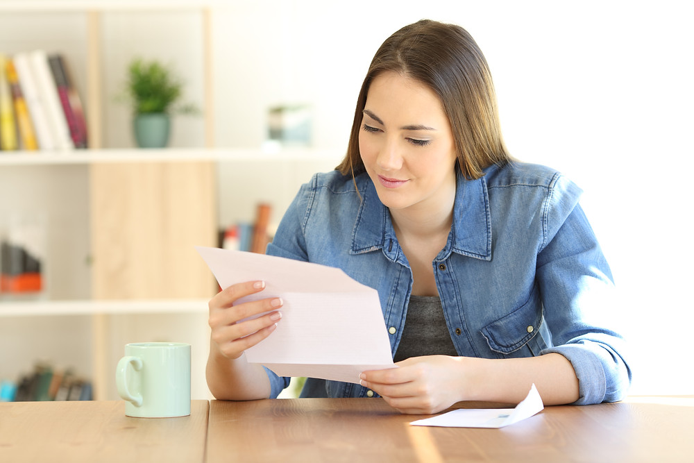 insurance customer reads mail from insurance agency