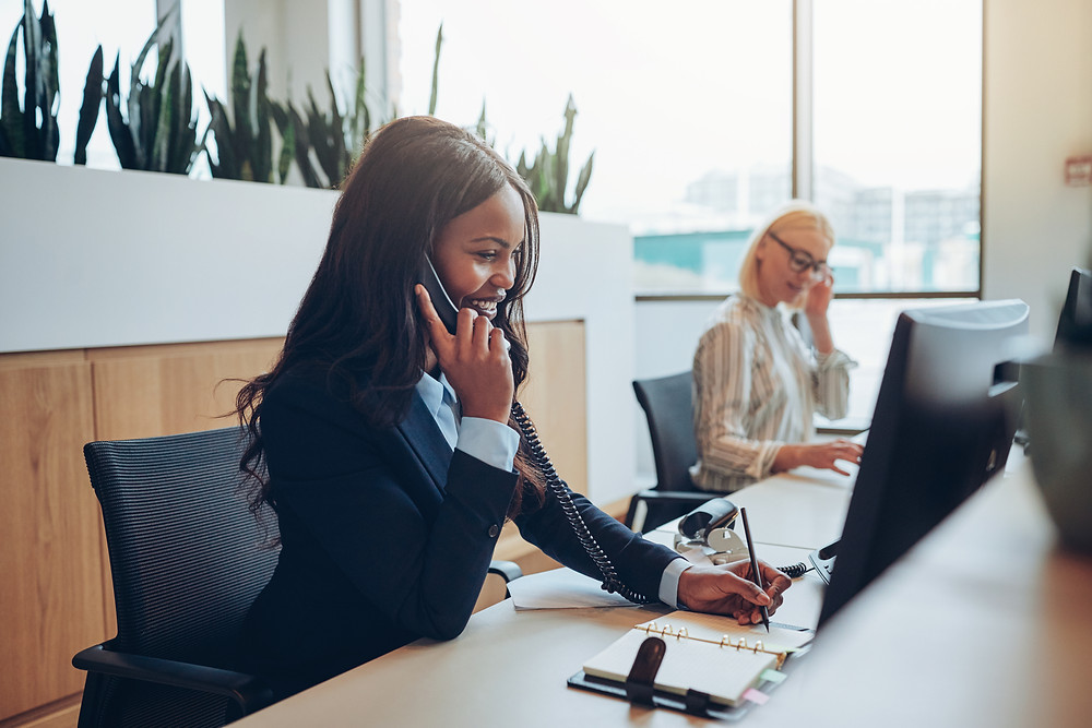 Insurance staff reach out to customers by phone to schedule policy review appointments.