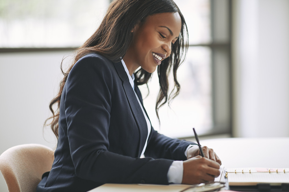 Insurance agent marks off action items from her to-do list.