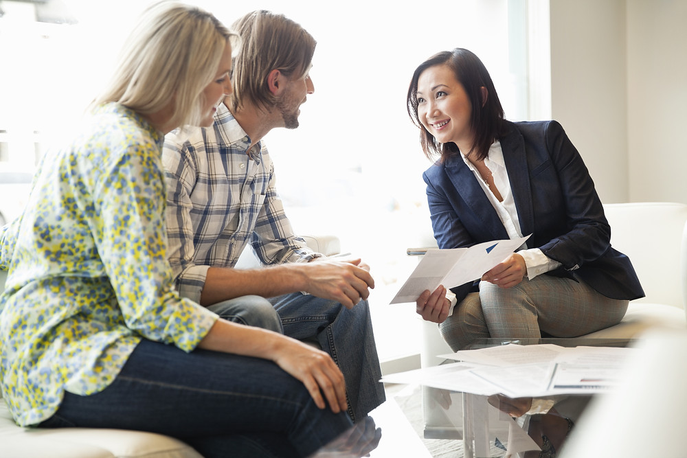 Insurance agent teaches clients about their coverage options.