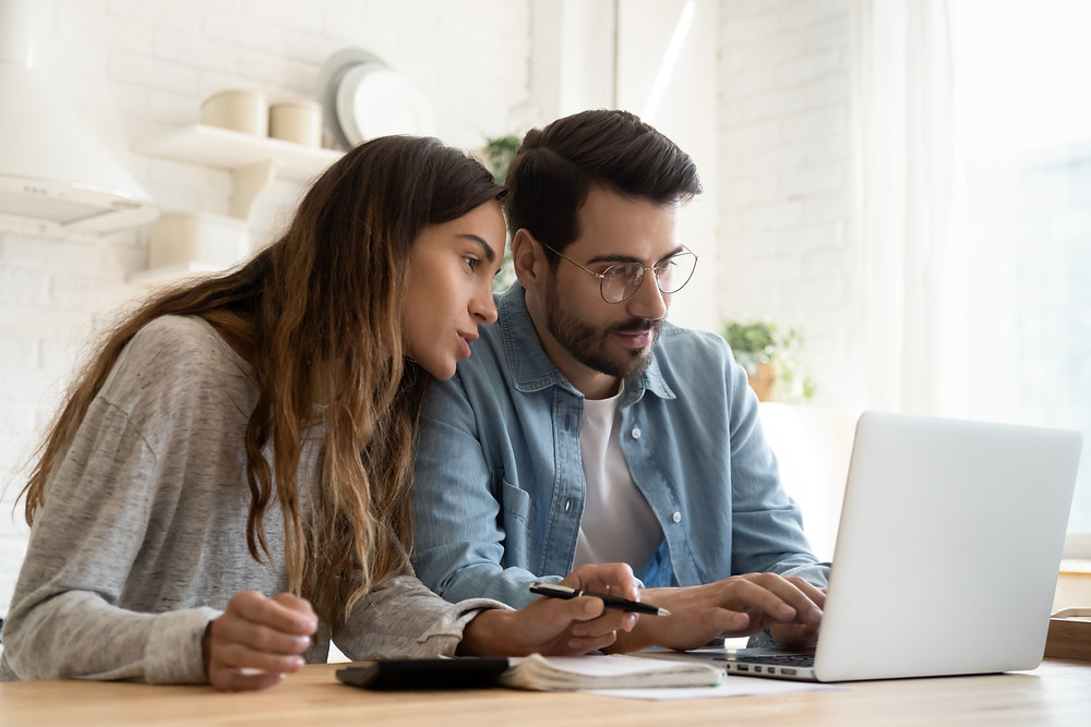 Young couple browses the web for insurance options