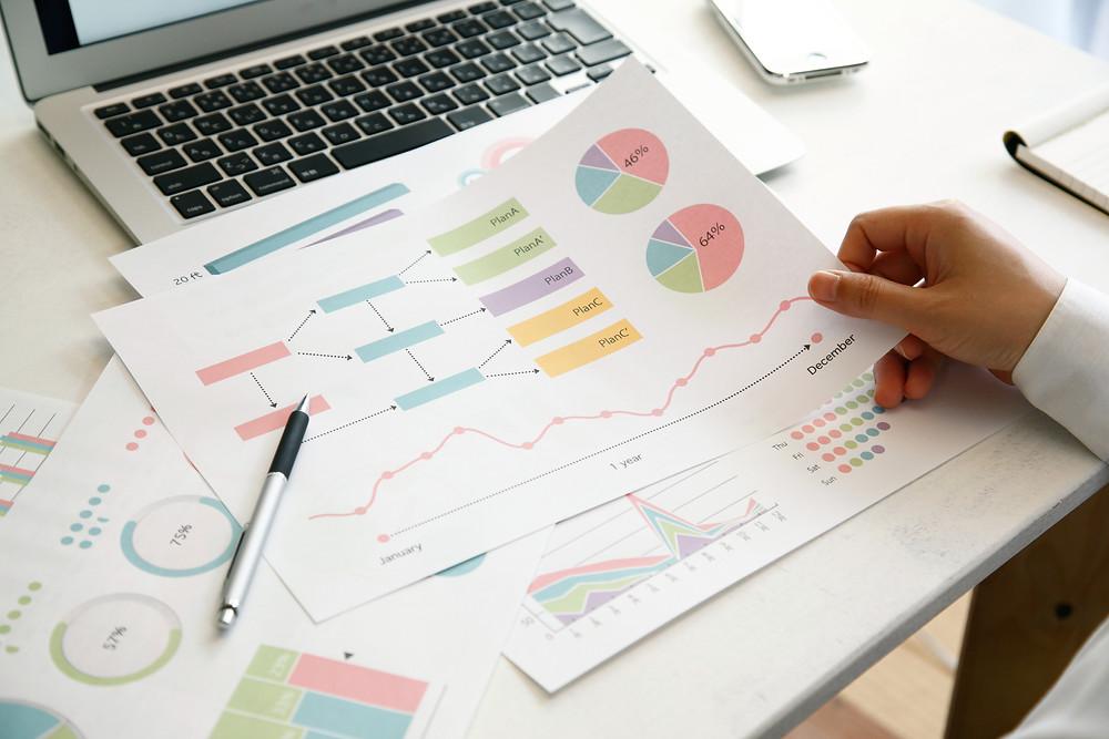 Desktop of graphs and charts for insurance customer segmentation.