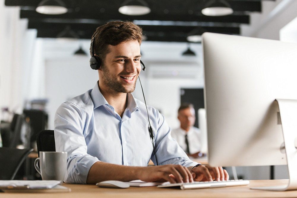 Call center appointment setter speaks with clients to set up insurance review appointments