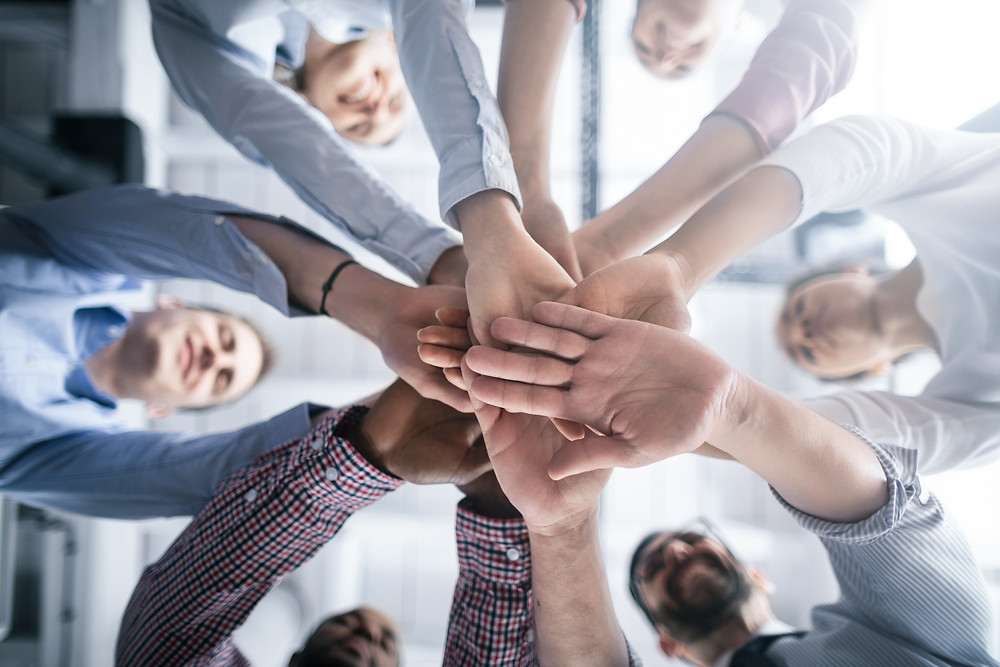 Insurance agency staff huddles together.