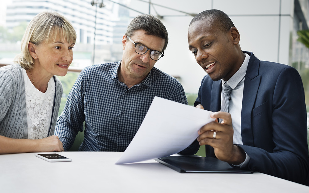 Insurance agent meets with customers to update their policies.