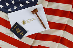US Passports with wooden judge gavel on