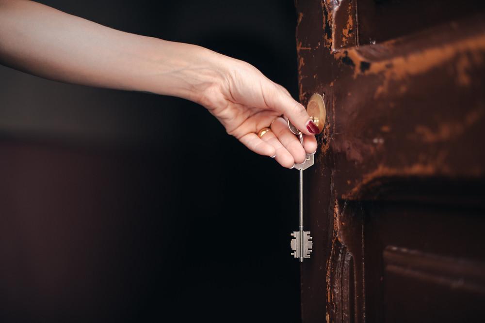 Photo of woman opening door. Credit: Matthew Henry