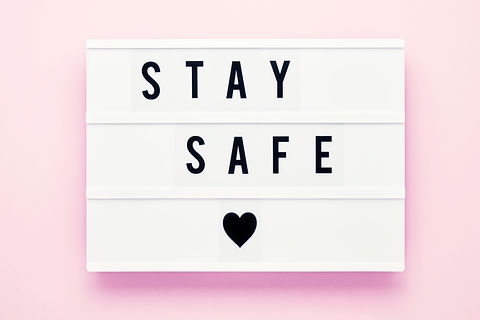 STAY SAFE written in light box on pink b
