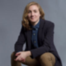 Picture of white androgynous person looking into camera