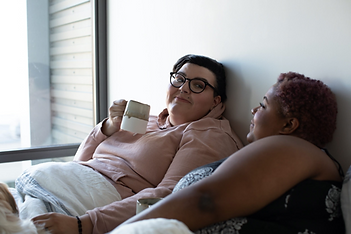 Women In Relationship Share Morning Coffee In Bed Together