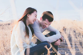 A Younger Woman And Man In Relationship Share A Good Laugh Together