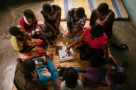 MSF community health worker Judith Mphaleya conducts a health promotion session with a sex worker community ART group in Nsanje. She uses interactive flip charts designed by sex workers or other teaching methods to promote knowledge of safer sex, HIV and STI prevention, sexual and gender based violence, hygiene, family planning & contraception and cervical cancer.  Judith is trained to answer questions sex workers might have on their HIV treatment, or advice on  challenges they face.