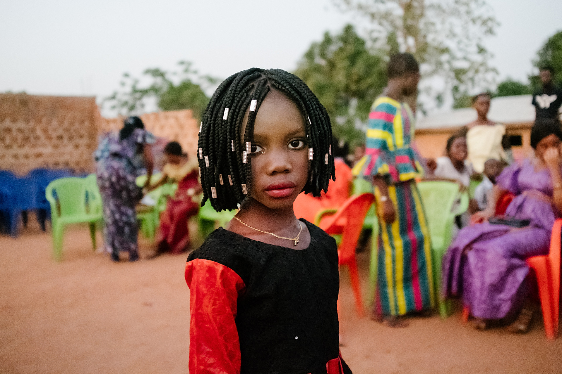 One of the celebrated girls poses for a photo during a circumcision party in Kindia, Guinea. About a month after the circumcision a big party is organized for the girls who have been circumcised. The girls are dressed up in young ladies' dresses. They all get the same haircut.  *** This gallery has only one image. Please close X.