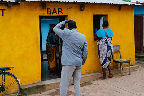 A bar in Dedza, close to the border of Mozambique. Nearby are rented rooms used for entertaining clients which belong to the bar owner. Sex workers live in communities close to the border area, meeting seasonal workers and truck drivers as they arrive or visit the area's local bars. - In Malawi, where poverty and unemployment remain high, many women turn to sex work – offering sexual services in exchange for payment of some sort - to support themselves and their families. Sex workers find themselves in high demand throughout night spots and drinking venues in cities of trade and along the busy trade and transport hubs, where truck drivers pass through.  In Mwanza, Zalewa and Dedza, three towns in western Malawi known as transport hubs, the presence of truck drivers, seasonal and industrial workers attracts a lot of sex workers who openly offer their services in hotspots and drinking venues, and often live in accommodation next to bars in exchange for providing services. In Nsanje, a more rural district in the south and one of the country's poorest where men travel for seasonal jobs in sugar plantations, many women operate more secretly through informal networks and who often live with husbands and families. Since 2014, MSF has been developing ways to reach sex workers and MSM (men who have sex with men) along main transport routes or busy centres of trade between Mozambique and Malawi through its 'key populations' projects. In Malawi, the project focuses only on female sex workers, and is located over four sites (across Mwanza, Dedza, Nsanje districts and Zalewa in Neno district ) and targeted towards female sex workers who each exist somewhere along the fluid continuum between 'transactional' and 'commercial' sex work. By the end of 2018, of the 5171 sex workers ever enrolled in the Malawi program, 1797 female sex workers were actively attending sessions and clinic visits at the four sites combined. Of the 5171 sex workers enrolled, out of 5021 tested, 2527 sex wor