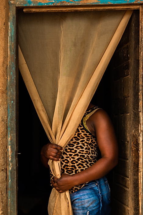 An unidentified sex worker stands in the doorway of one of the rented rooms next to a hotspot bar where she lives and works in Dedza town centre.  - In Malawi, where poverty and unemployment remain high, many women turn to sex work – offering sexual services in exchange for payment of some sort - to support themselves and their families. Sex workers find themselves in high demand throughout night spots and drinking venues in cities of trade and along the busy trade and transport hubs.  Comprehensive care in the community and health education In all four project sites (IMwanza, Dedza, Nsanje districts and Zalewa in Neno district ), MSF community health workers (who are themselves sex workers) visit communities and hotspots with a backpack of health promotion tools, which they use to conduct health education sessions. Topics include safer sex, HIV and STI prevention, sexual and gender based violence, hygiene, family planning & contraception and TB and cervical cancer. They also provide sex workers with condoms, lubricant, initial doses of PEP (post-exposure prophylaxis), pregnancy testing and sexual violence screening, and emergency contraception methods. A lay counsellor supports HIV testing services, counselling, TB and STI screenings and referrals. From the community the community health workers help to identify and navigate sex workers in need of medical care to MSF-run 'one-stop' clinics which are located in public health facilities run by the Ministry of Health.