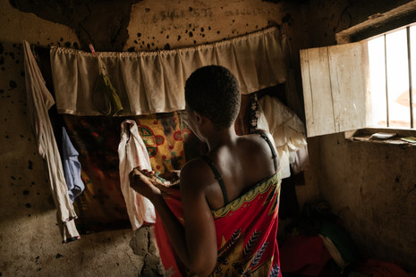 A sex worker gets ready for work in her rented room that she also uses for clients in a compound where she lives together with other sex workers in Nsanje.   - In Malawi, where poverty and unemployment remain high, many women turn to sex work – offering sexual services in exchange for payment of some sort - to support themselves and their families. Sex workers find themselves in high demand throughout night spots and drinking venues in cities of trade and along the busy trade and transport hubs, where truck drivers pass through.  Sex workers face much higher risks of contracting HIV, STIs and unwanted pregnancies than women not engaged in sex work. Overall, sex workers in Malawi are 5.4 times more at risk of contracting HIV than their counterparts in the general population.  Since 2014, MSF has been developing ways to reach sex workers and MSM (men who have sex with men) along main transport routes or busy centres of trade between Mozambique and Malawi through its 'key populations' projects. In Malawi, the project focuses only on female sex workers, and is located over four sites (across Mwanza, Dedza, Nsanje districts and Zalewa in Neno district ) and targeted towards female sex workers who each exist somewhere along the fluid continuum between 'transactional' and 'commercial' sex work. By the end of 2018, of the 5171 sex workers ever enrolled in the Malawi program, 1797 female sex workers were actively attending sessions and clinic visits at the four sites combined. Of the 5171 sex workers enrolled, out of 5021 tested, 2527 sex workers were HIV positive (50%) of which 1811 (72%) were enrolled onto the national ART program, while 863 (48%) were 'active' (seen within the last nine months) and 494/579 of the total were virally suppressed (85%).
