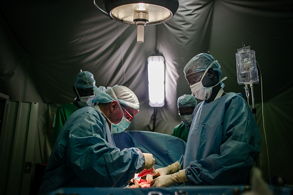 Jose Sanchez Giron Delgado and his team working on a spear injury. The doctor is still active as an MSF surgeon.