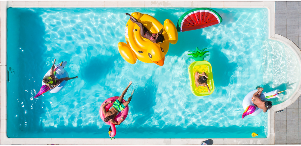 swimming pool, people swimming, chilling, relaxing, sunbathing, hanging around with friends on fruit-shaped float in the pool, flamingo, unicorn, pineapple, watermelon, duck, happy, relaxed, youth, millennials, stunning swimming pool, malaysia