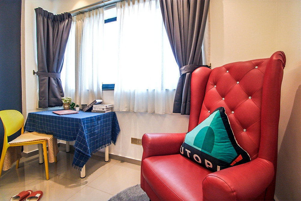 Utopia co-living pillow in a modern, luxurious room in malaysia, kuala lumpur, rental room with desk and study table, chair affordable room to rent in KL, red vampire sofa