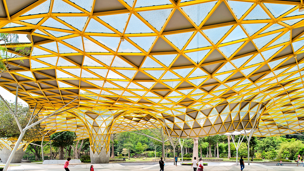 great, captivating modern yellow structure of recreational park in perdana botanical garden in kuala lumpur malaysia, surrounded with green nature, relax, chill with family and friends