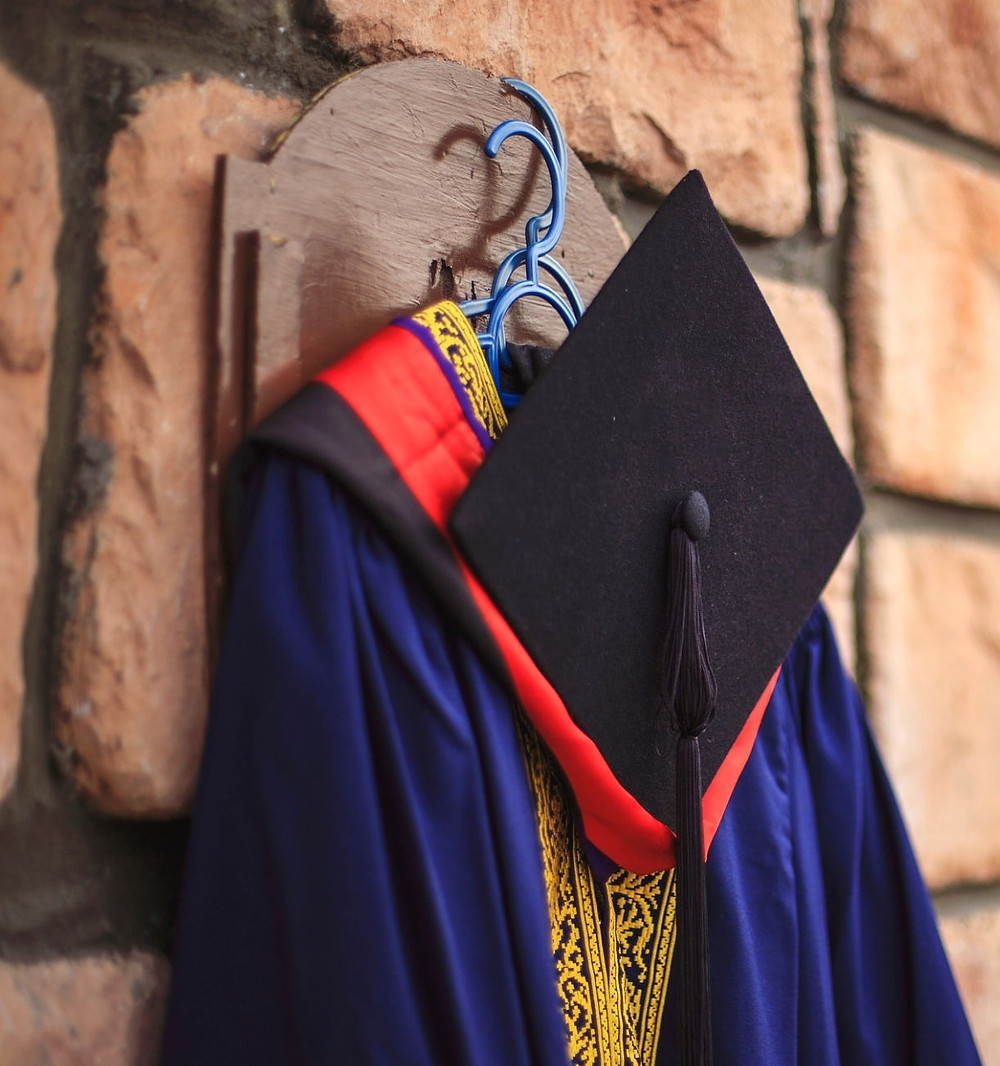 Graduation gown with mortarboard hanging on the wall in Malaysia