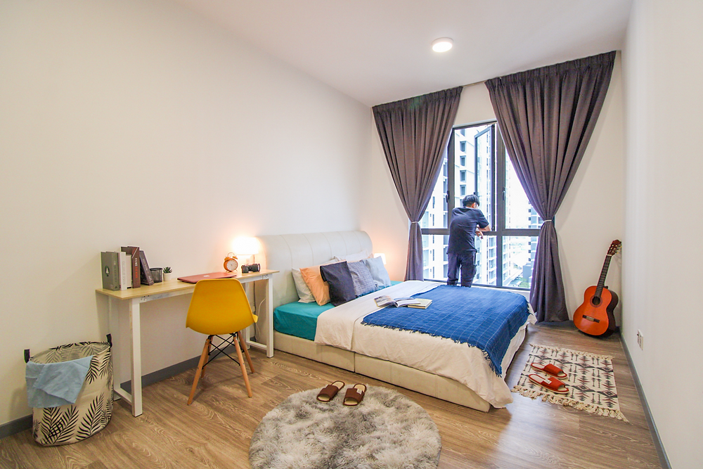 spacious room in Kuala Lumpur to rent by Utopia Co-Living, modern room with aesthetic decoration, bedroom, study table, white, modern, clean affordable, cheap room in malaysia, guitar in room, fluffy carpet