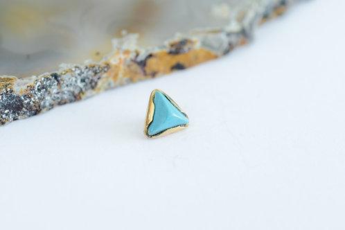 Triangulo de oro y turquesa