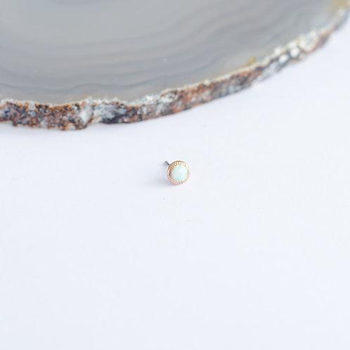 top redondo con opalo y borde decorado