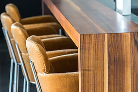 Cropped image of light brown velvet chairs and wooden counter top in Maple Ridge B.C.