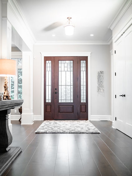 Dark brown front door and dark brown hardwood floors in Fort Langley B.C.
