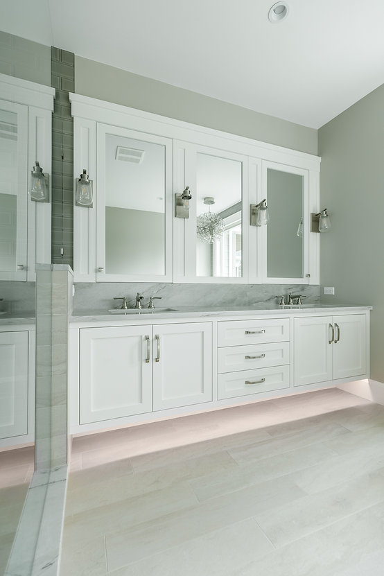 Fresh traditional white cabinets with LED lights and tungsten light fixtures in Langley B.C.