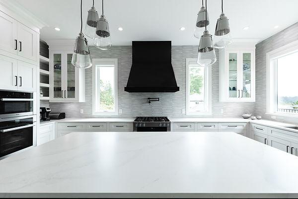 Custom kitchen design, kitchen island and black kitchen hood in Surrey B.C.