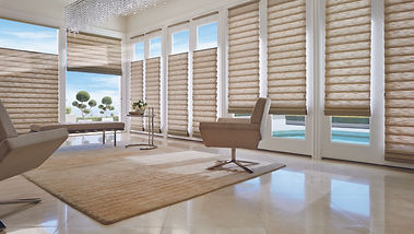 Hunter Douglas shades in living room with two light brown chairs.