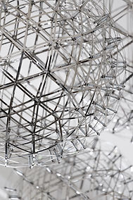 Cropped image of hanging silver, spherical light fixtures.