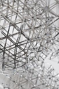 Close up shot of the metal spherical light fixture.