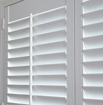 A close up of white shutters.